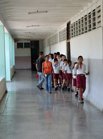 Children finding their way down the corridor along the wall