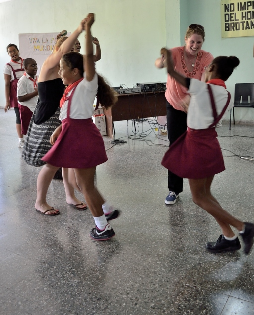 Sally and Susan dancing with 2 of the students of the school